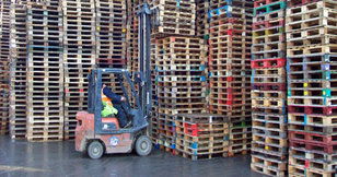 Forktruck and stacks of pallets